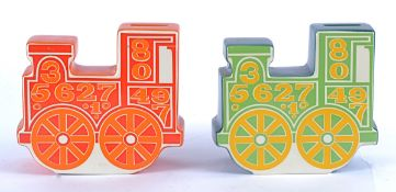 Two Carlton ware retro money banks in the form of locomotives, with psychedelic style designs, one