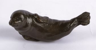 Rosalie Johnson (Contemporary British) a bronze study of a seal pup, a limited edition of which this