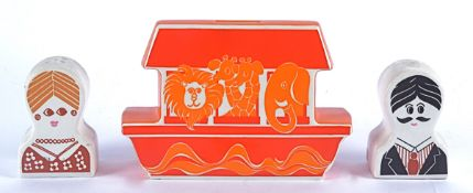 A Carlton ware retro money bank in the form of Noah's Arc, with psychedelic style design, in red and