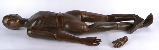 A hand carved fully articulated artist's mannequin or lay figure, stained pine, one hand unattached,