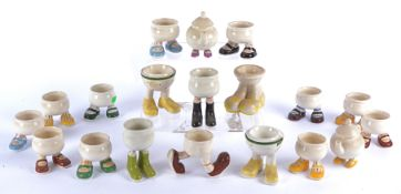 Seventeen egg cups from the Carlton Ware 'Walking Ware' series, in a variety of designs in various