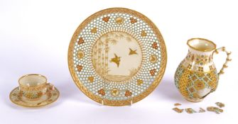 Four pieces of late Victorian Aesthetic Movement reticulated Royal Worcester porcelain in the manner