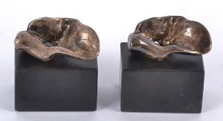 Two Eli Ilan (1928-1982) abstract silver sculptures, on black plinth bases, later recasting,