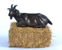 Rosalie Johnson (Contemporary British) a bronze study of a restful goat, a limited edition of