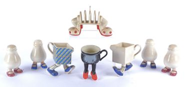 Four Carlton Ware 'Walking Ware' salt and pepper pots, one pair with blue shoes the other with