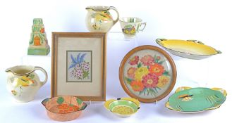 A group of various oval pottery dishes dating to the 1930's and later with bright bold colouring, to