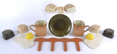 A pair of Carlton Ware egg cups and stands taking the form of fried eggs, length 17cm, together with