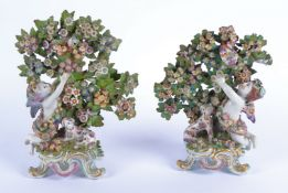 A pair of early English porcelain polychrome figures, probably 18th Century Chelsea red anchor