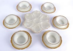 A group of nine small French porcelain saucers and bowls with Greek key borders, all of floriform