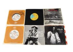 """Neil Young Promo 7"""" Singles, approximately thirty promo 7"""" singles by Neil Young and related bands"""