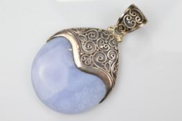 A certificated blue lace agate and silver pendant, the polished disc encased in filigree mount