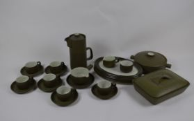 A Denby stoneware dinner set with dark green ground and chevrons, including a coffee pot, plates,
