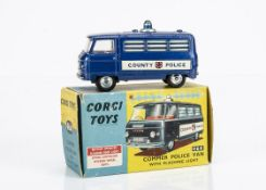 A Corgi Toys 464 Commer Police Van, dark blue body, 'County Police' decals, window bars, blue roof