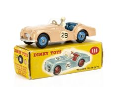 A Dinky Toys 111 Triumph TR2 Sports, competition finish, salmon pink body, blue interior and hubs,
