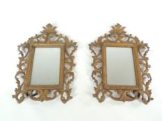 A pair of 20th Century freestanding cast metal gilt frames containing mirrors, 30cm x 20cm (2)