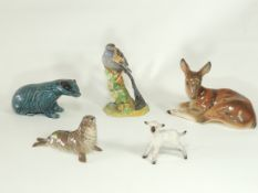 Six ceramic figures of wildlife from the British Isles to include a Poole pottery badger, height