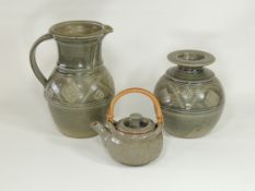Three items of 20th Century studio pottery with green glaze speckled with marks of oxidisation,