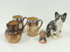 A Winstanley pottery cat, with characteristic yellow glass eyes, signed 'Winstanley' to base and