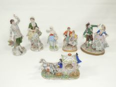 A pair of 20th Century Sitzendorf porcelain figures, a young woman and a young gentleman both