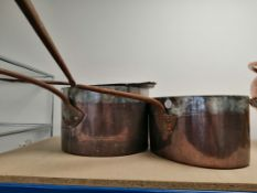 A group of three 19th century Victorian country house kitchen copper saucepans, each with