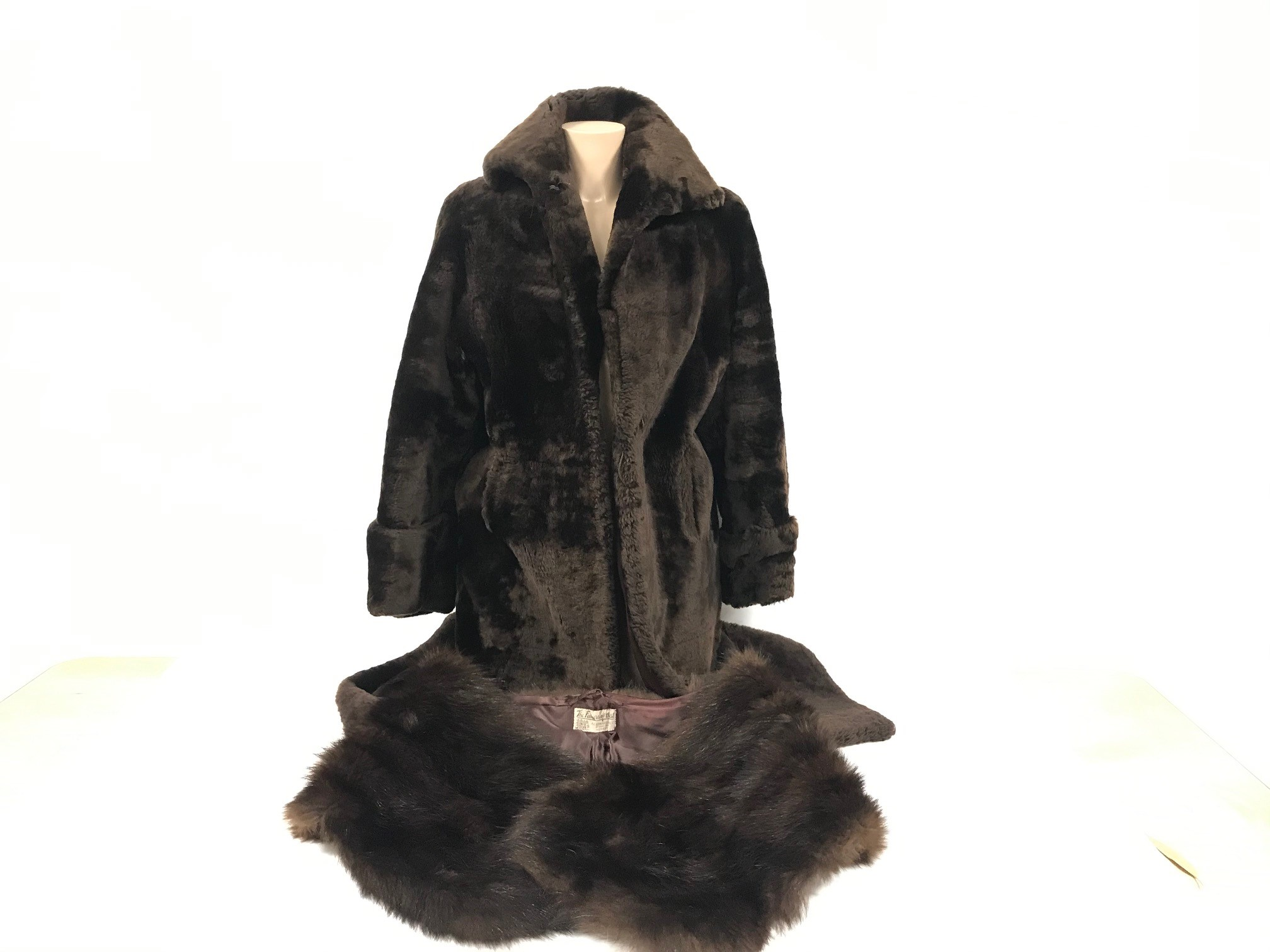 A three quarter length vintage fur coat from Tescan, together with a vintage fur shawl from A.E.