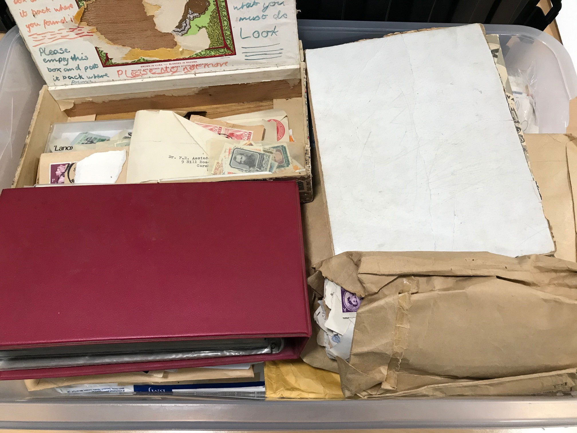 A box of Frist Day Covers and stamps and related ephemera