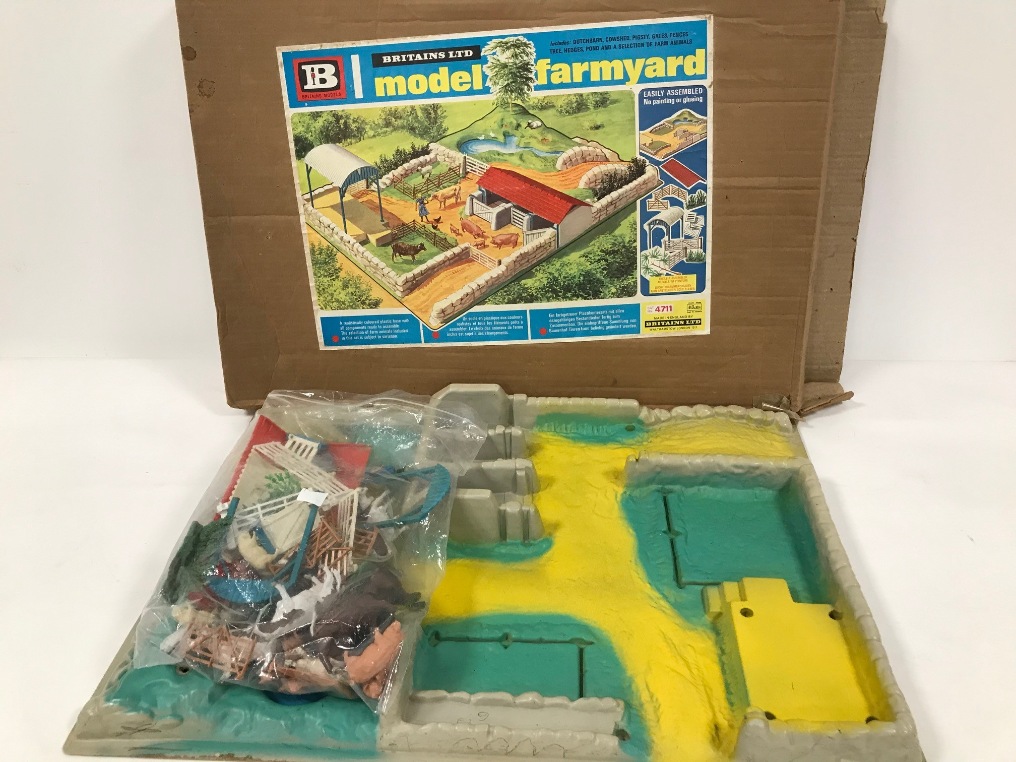 A Britain Ltd Model Farmyard, in box with group of Britains plastic farm yard animals and fences