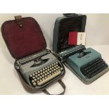 Two vintage typewritters, one a Royal Royalite in case, and an Underwood Olivetti Lettera 22 also in