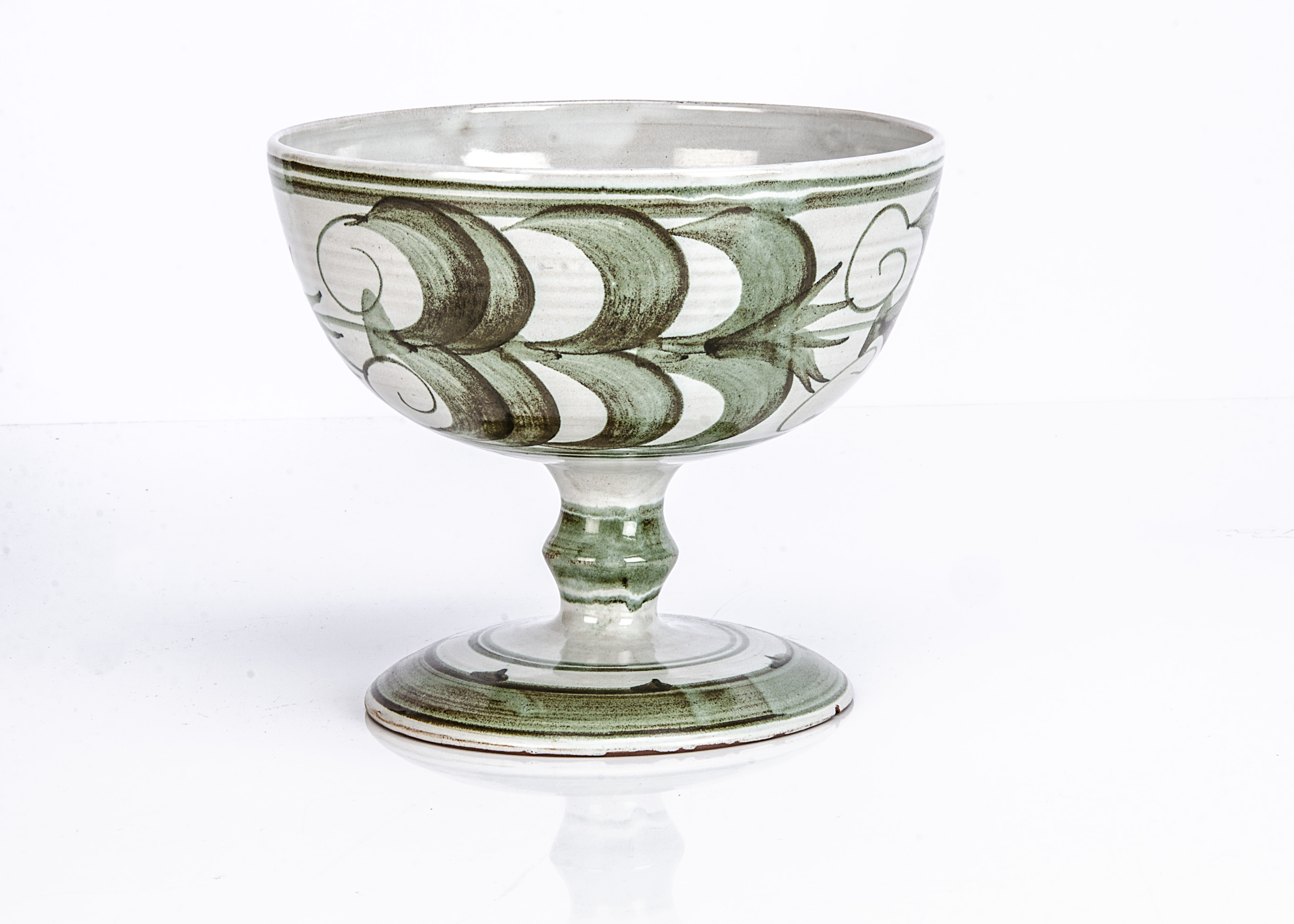 An Aldermaston Pottery footed bowl, with green decoration, signed VC to base, 19.5cm diameter and