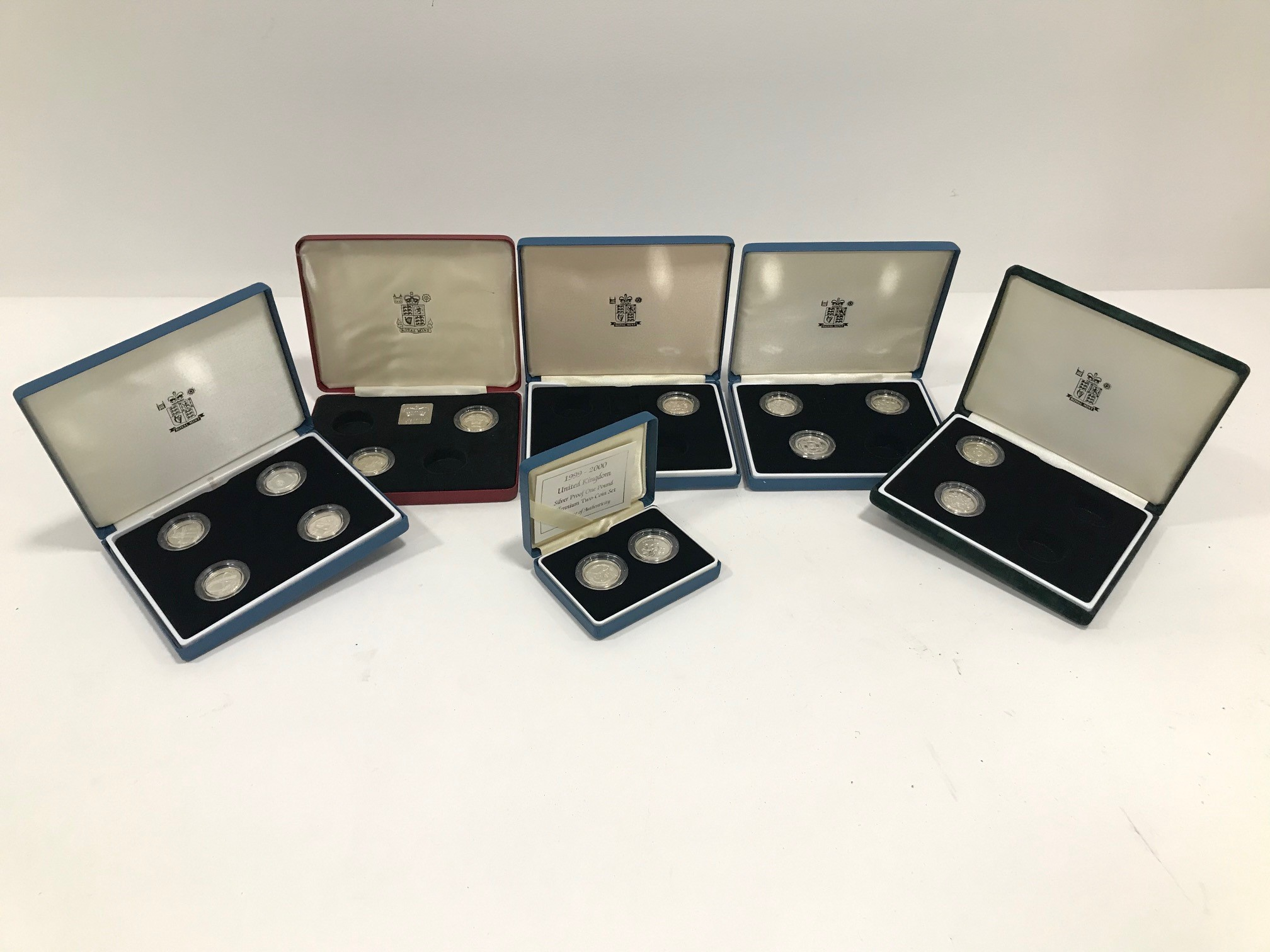 A group of fourteen Royal Mint silver proof £1 coins, in six boxes, dates from the 1980s up to