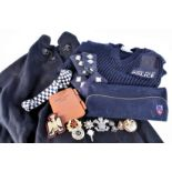 An assortment of Police Uniform items and badges, including a J Compton, Sons & Webb Ltd cape,