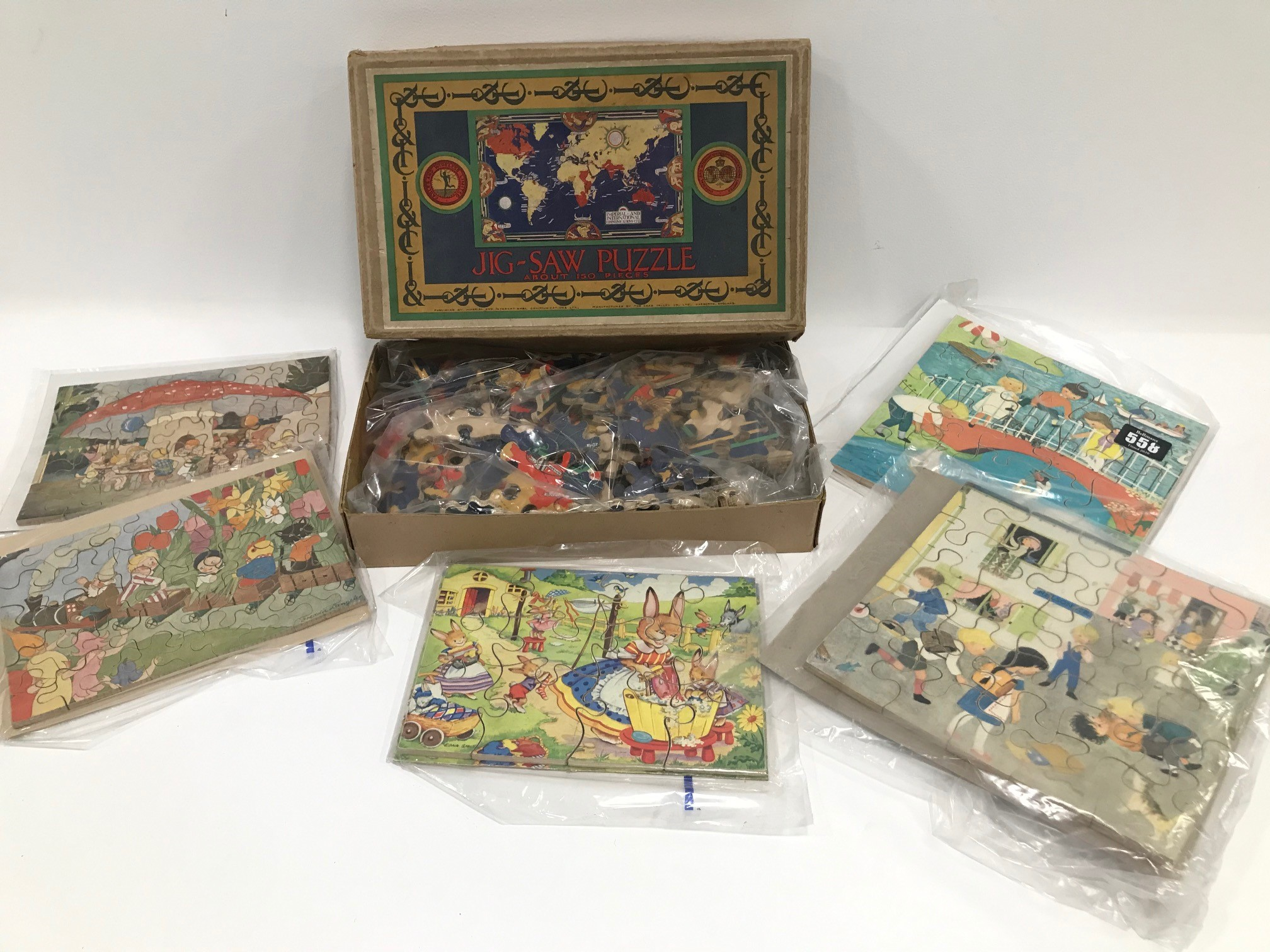 An Imperial & International Communications Limited wooden map of the world jigsaw puzzle, together