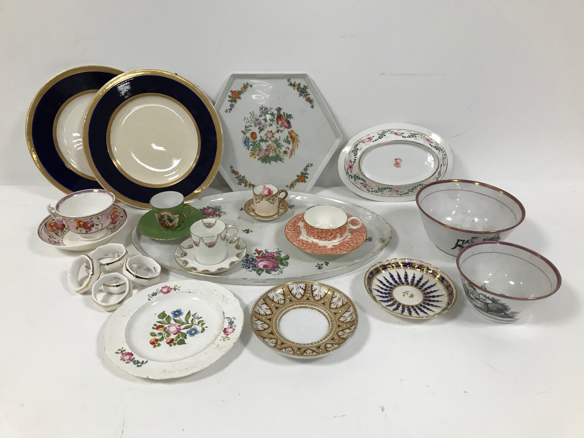 A collection of British ceramics, including a Royal Worcester trombleuse style cup and saucer, a