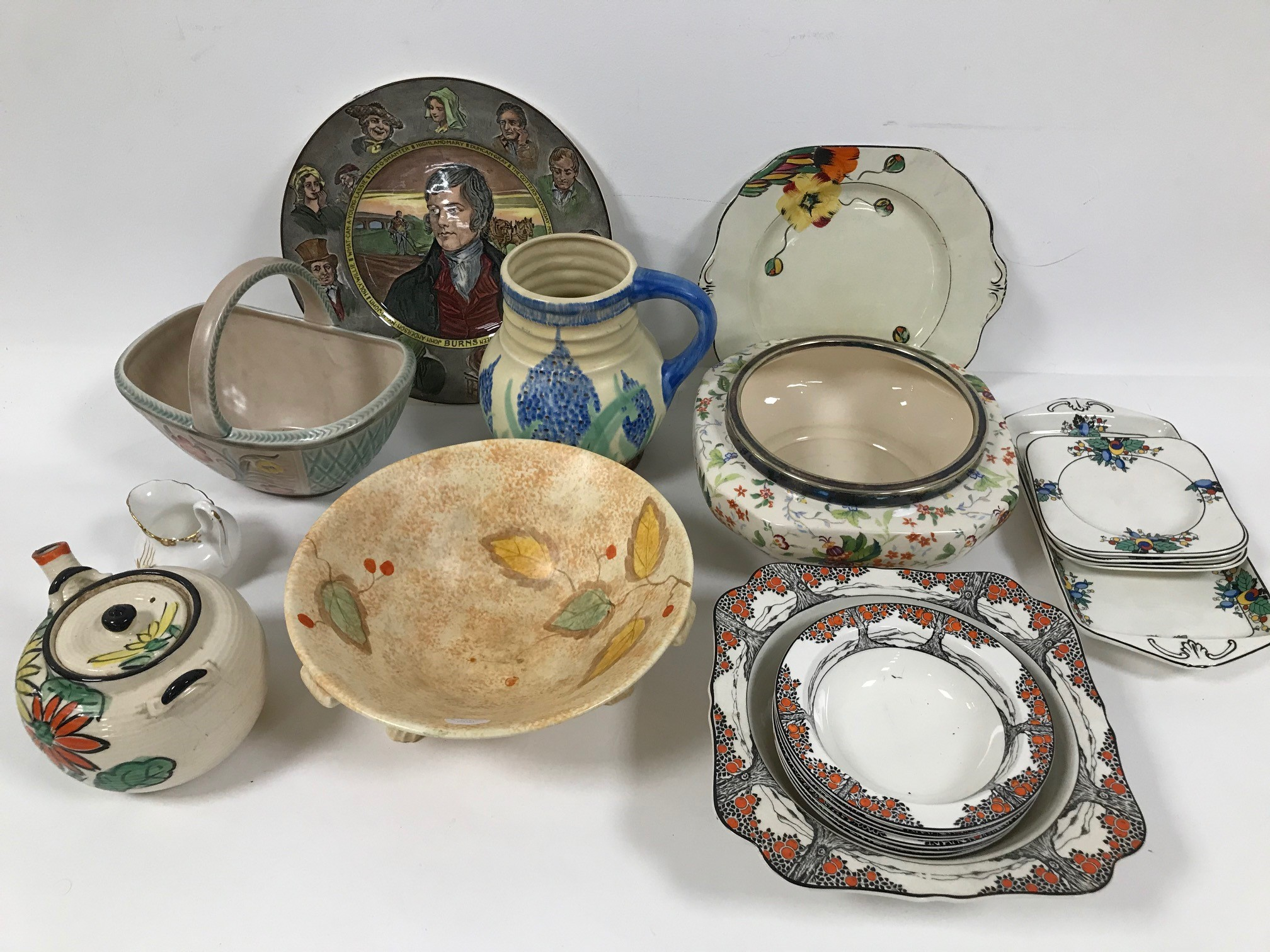 A collection of Art Deco and later ceramics, including a Royal Doulton Burns plate, a Roskyl pottery