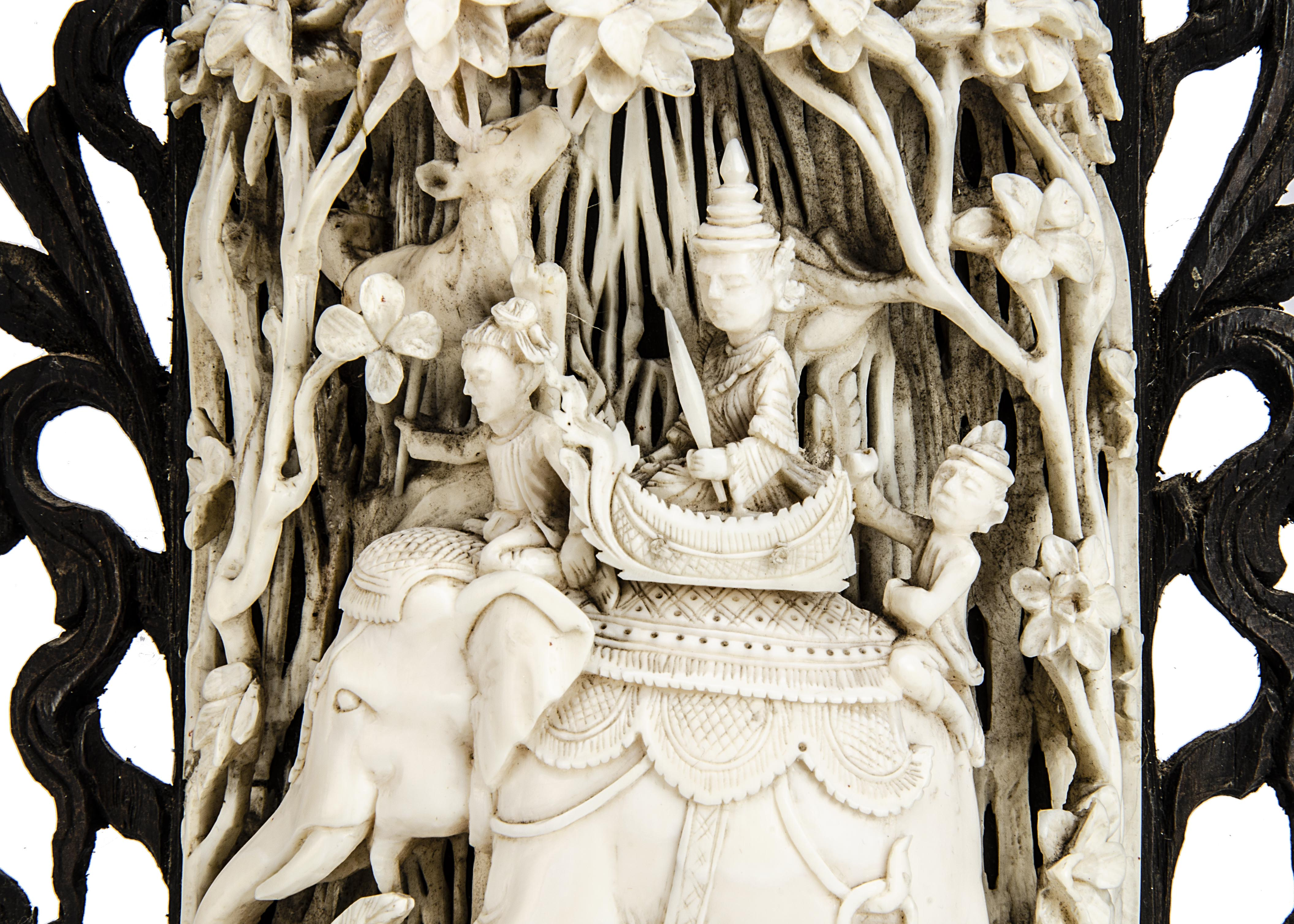 A late 19th century Indian carved ivory decoration, intricately carved with an elephant carrying - Image 3 of 3