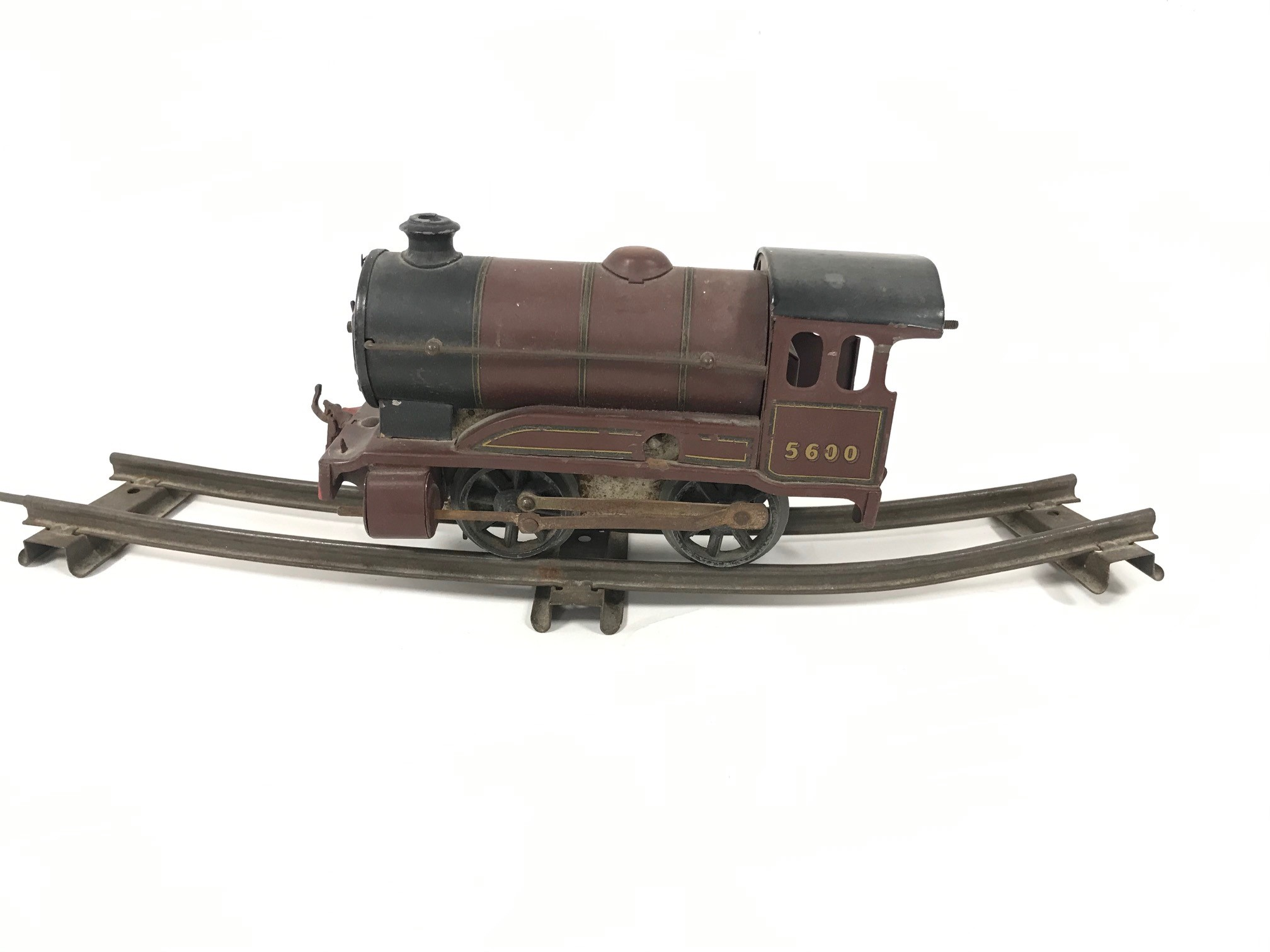 An Hornby 0 gauge clockwork locomotive, 0-4-0, in marron, marked 5600