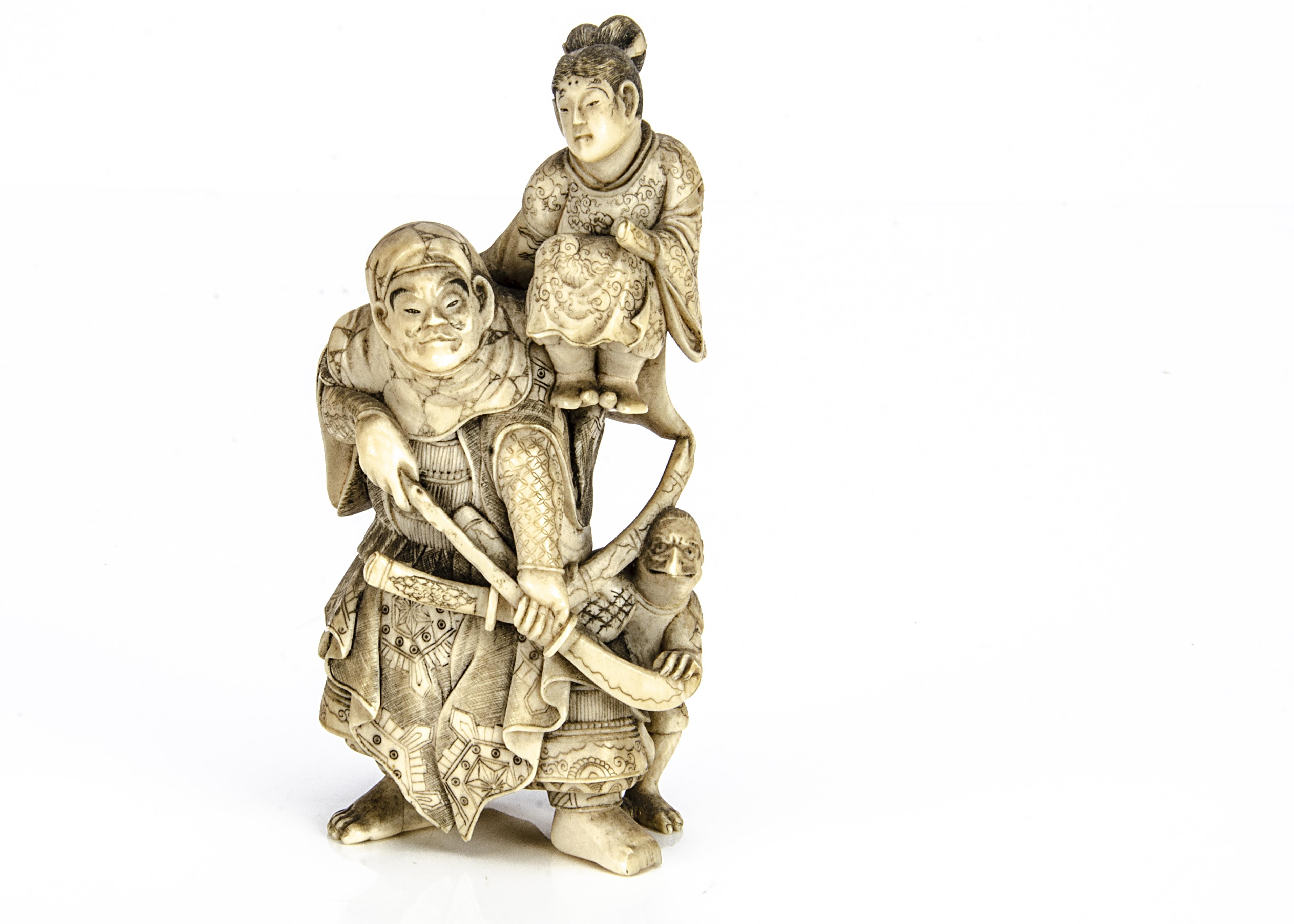 A Meiji period carved ivory okimono, of Minamoto Yorimasa watching as the samurai warrior Ino Hayata