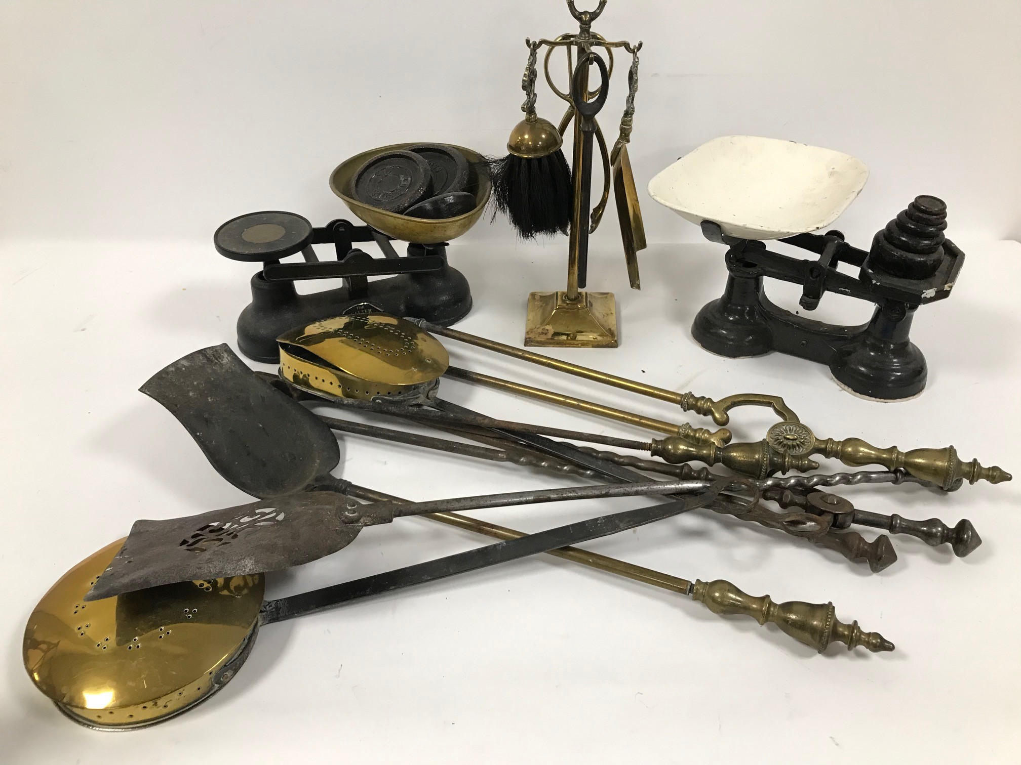 Two sets of vintage kitchen scales and weights, together with a small fire side companion and