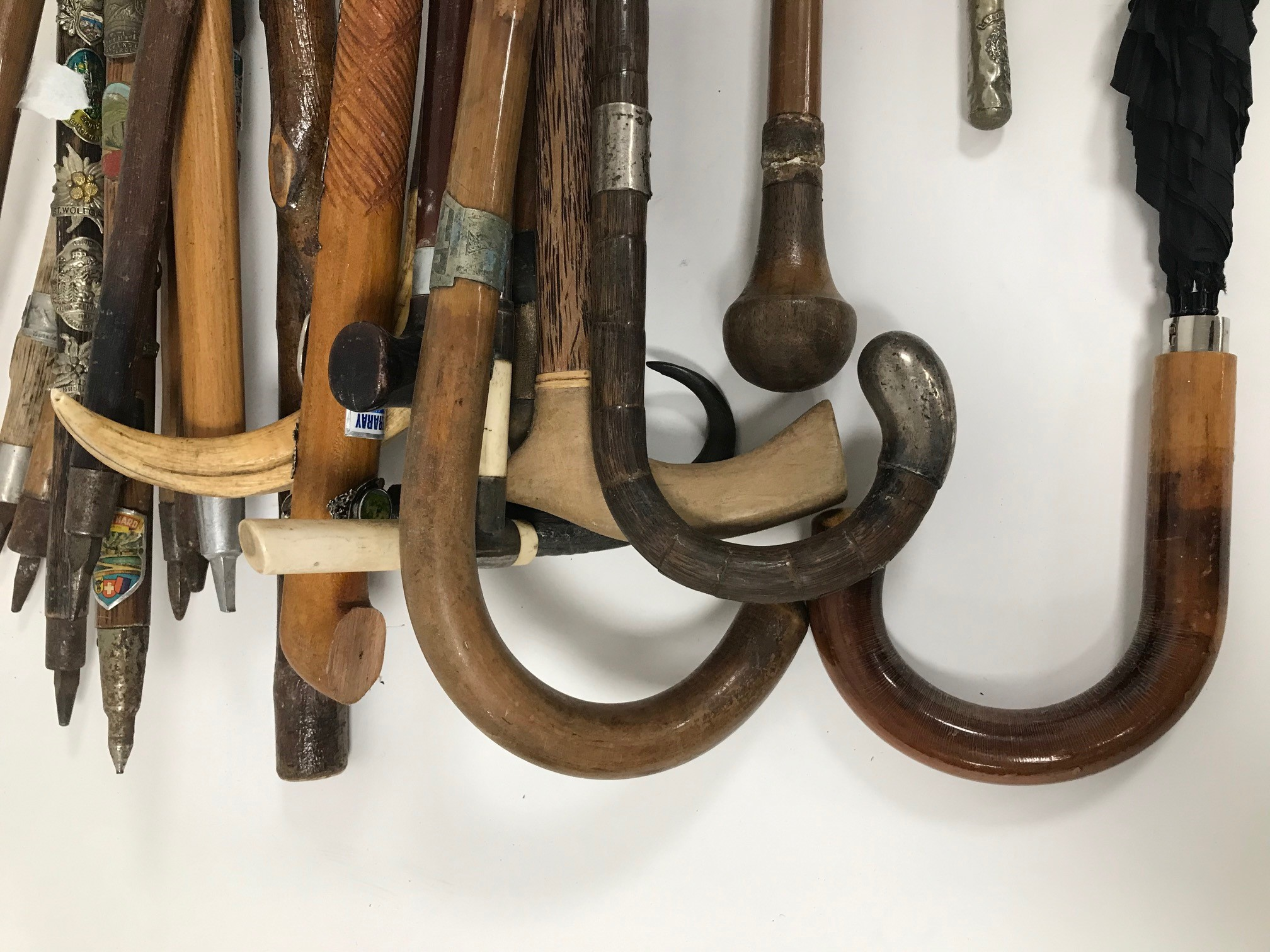 A collection of walking stick and canes, including a walking stick with removeable shaft to reveal - Image 2 of 3