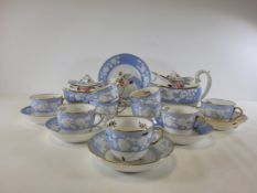 An early 19th Century Spode china tea service with boat shaped teapot, having hand painted sprigs of