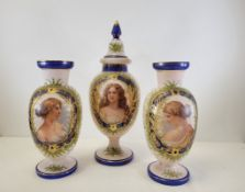 A garniture of late Victorian opaline glass vases including one covered example, each with