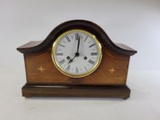 A 20th Century mahogany mantelpiece clock raised on four brass ball feet, with enamel dial and Roman