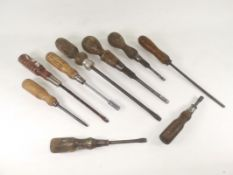A selection of 20th Century woodworking hand tools, a mixture of different sized screwdrivers,