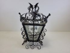 A pair of cast iron andirons, diameter 33cm, together with a nursery ware cup and saucer with '