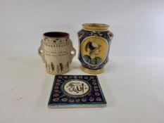 An Italian Maiolica tin glazed pottery alberro style jar pharmaceutical jar with two cartouches of