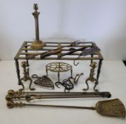 A quantity of brassware to include two andirons of spherical form, height 22cm, a lamp base in the
