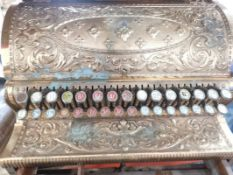 A heavily embossed decorative brass National Cash Register, 226148, Dayton Ohio USA, the single