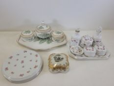 A group of Continental porcelain dressing table top items, to include covered pots, bottles and