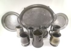 Victorian pewter quart measure, together with a quantity of pewter tankards and serving dishes,