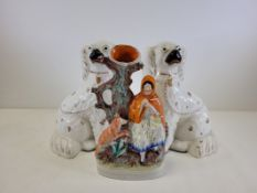 A pair of Staffordshire pottery spaniels, together with a Victorian Staffordshire flatback figure of
